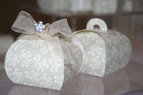 Vintage pearl grey Tortina boxes; left box with ivory organza ribbon and diamante accessory